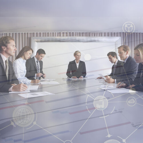Multiethnic business people with paperwork in meeting room