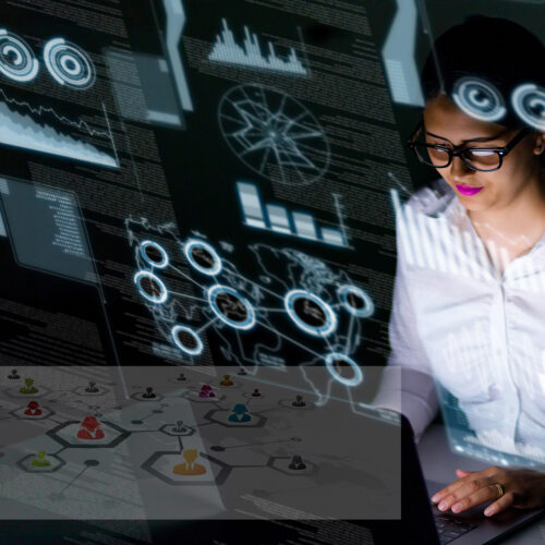 woman engineer looking at various information in screen of futur